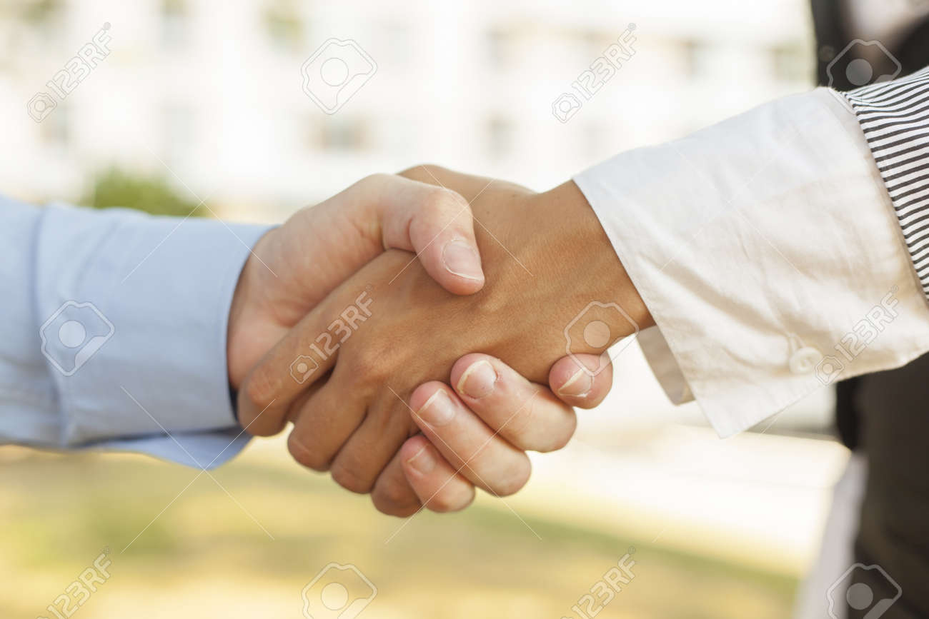 Businesspeople handshake - Woman and men shakinghand Stock Photo - 14620347
