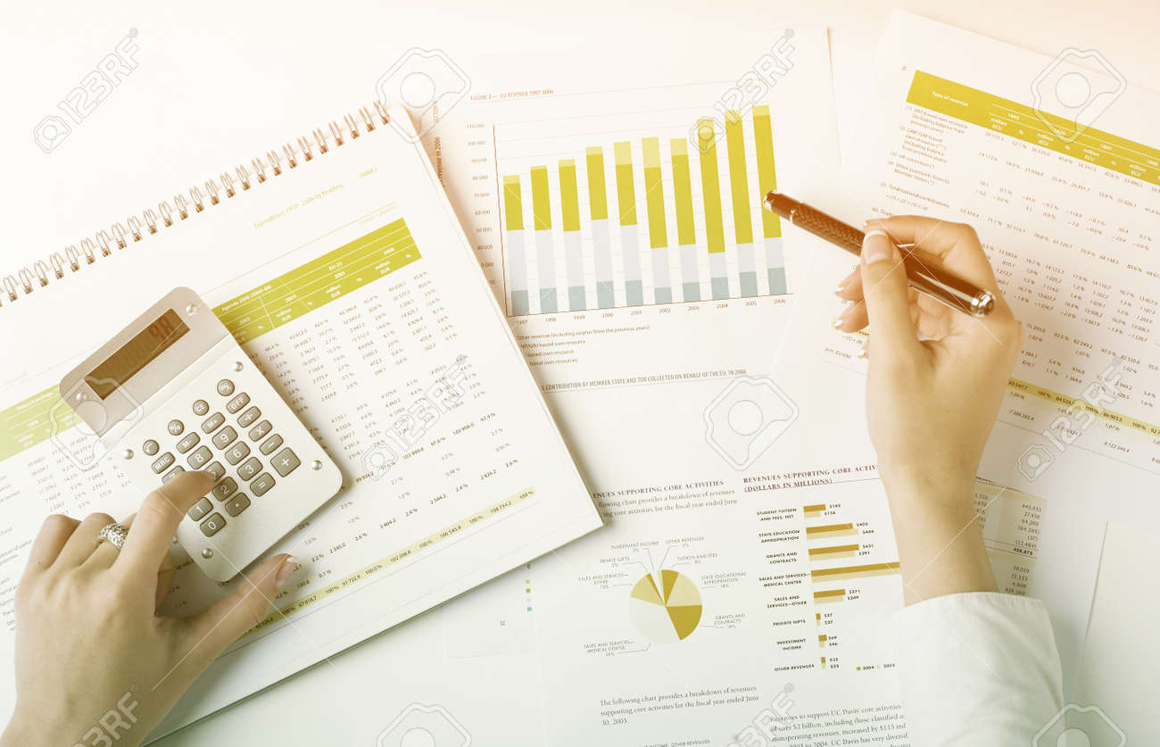 Market Analyze - pen and numbers on paper Stock Photo - 15214098
