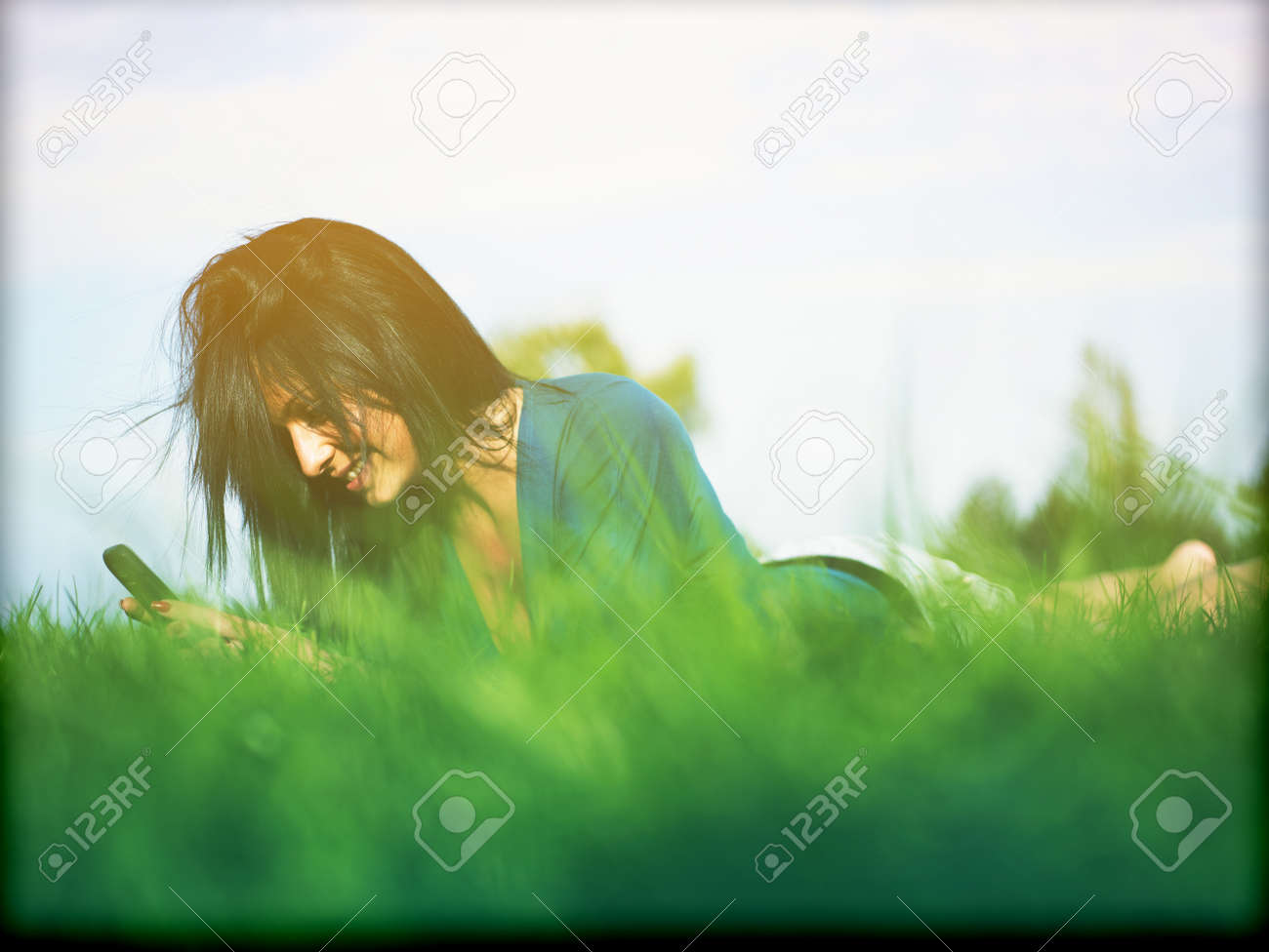 Young woman using laptop in park Stock Photo - 14932811