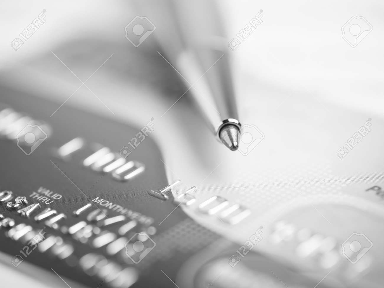 Close up a credit card and pen Stock Photo - 15214093