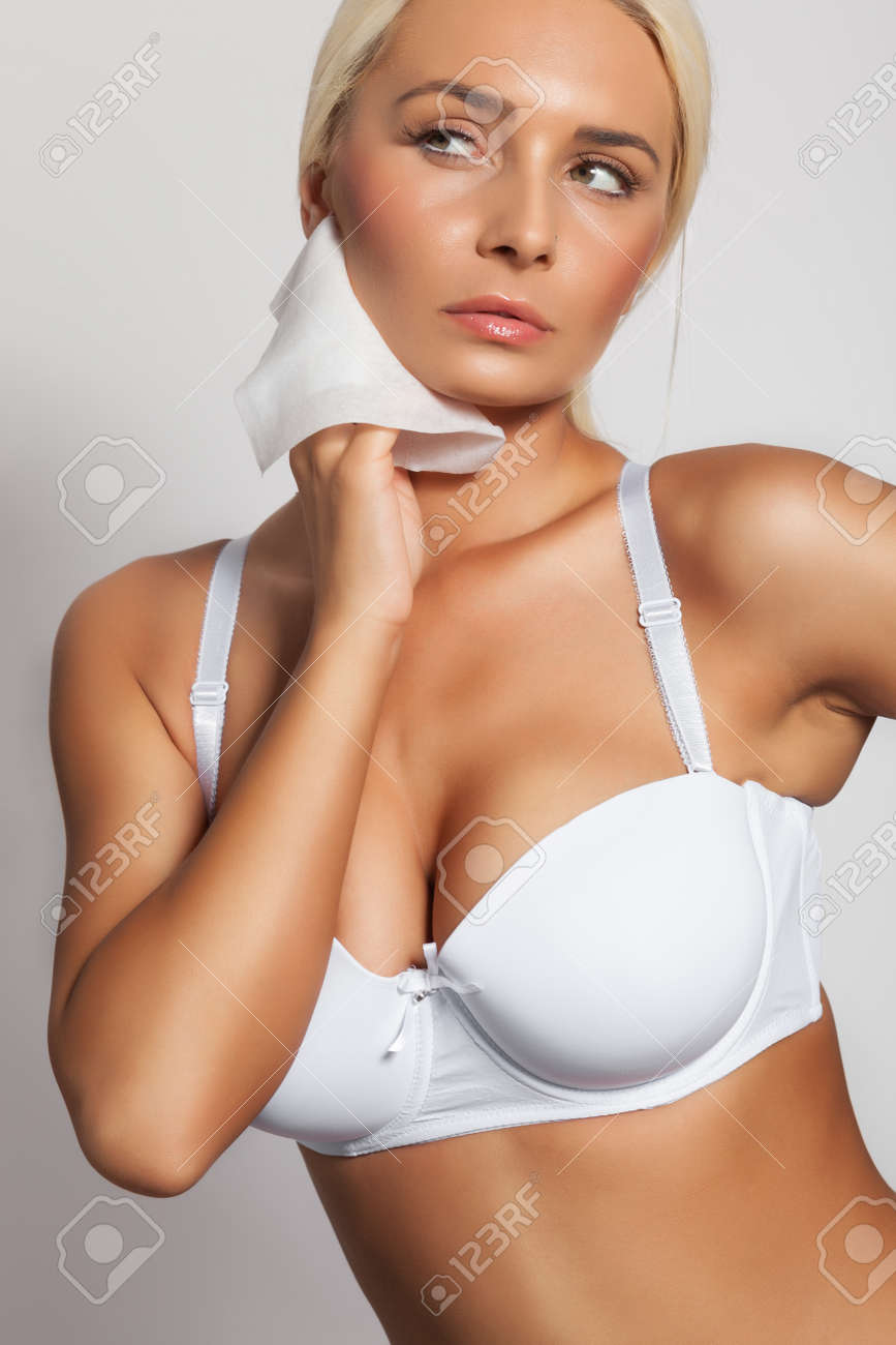 Stock Photo - Young woman clean neck with wet wipes fb80f2cbd