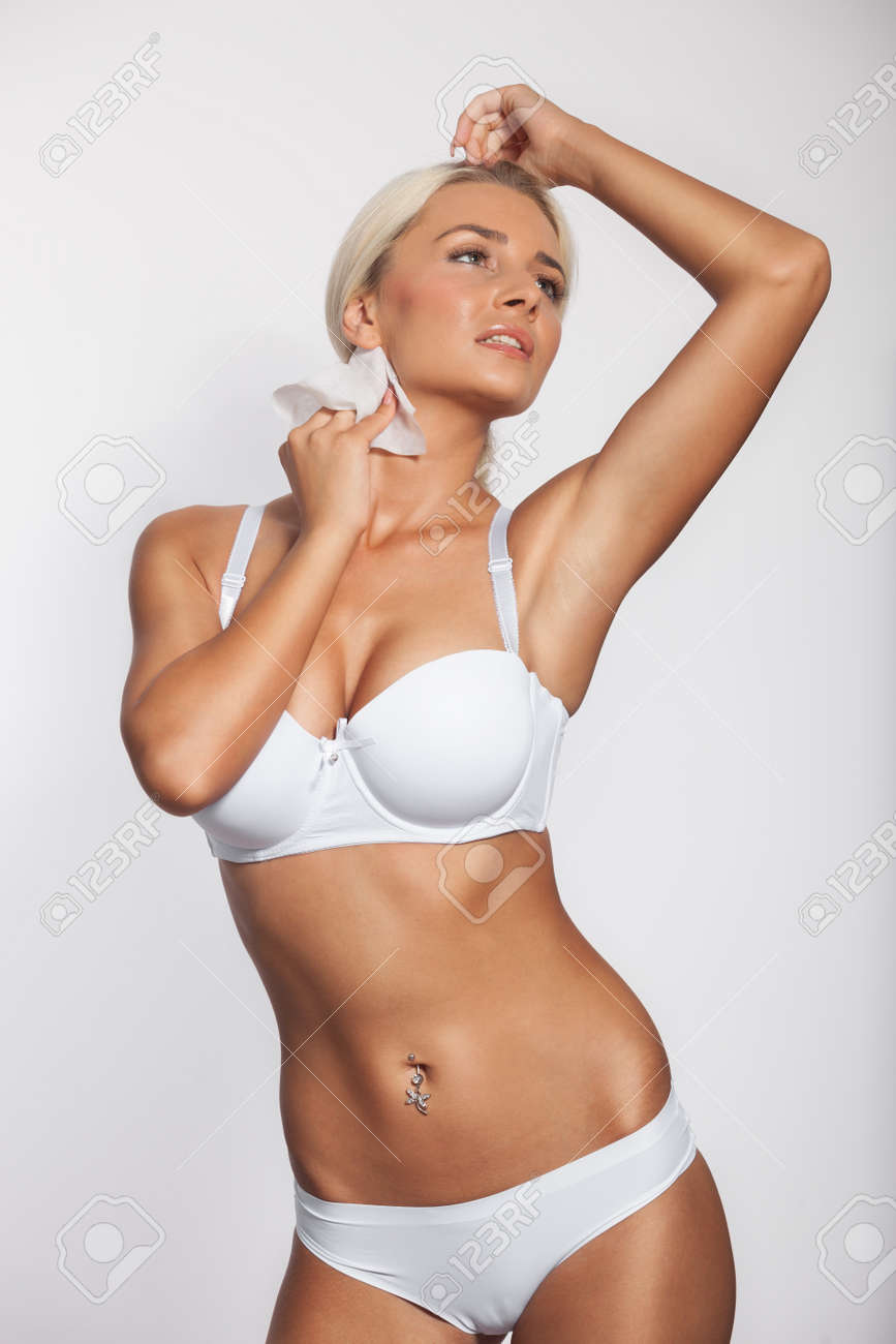Stock Photo - Young woman cleaning neck with wet wipes b56c952d4