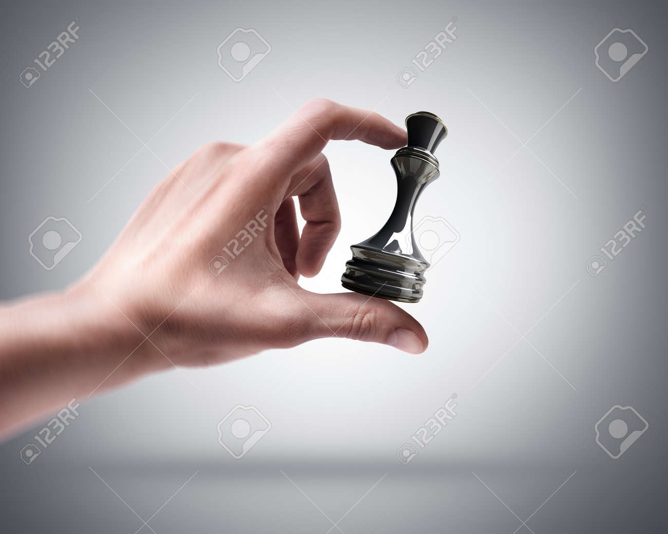 Man's hand holding chess Queen Stock Photo - 22211501