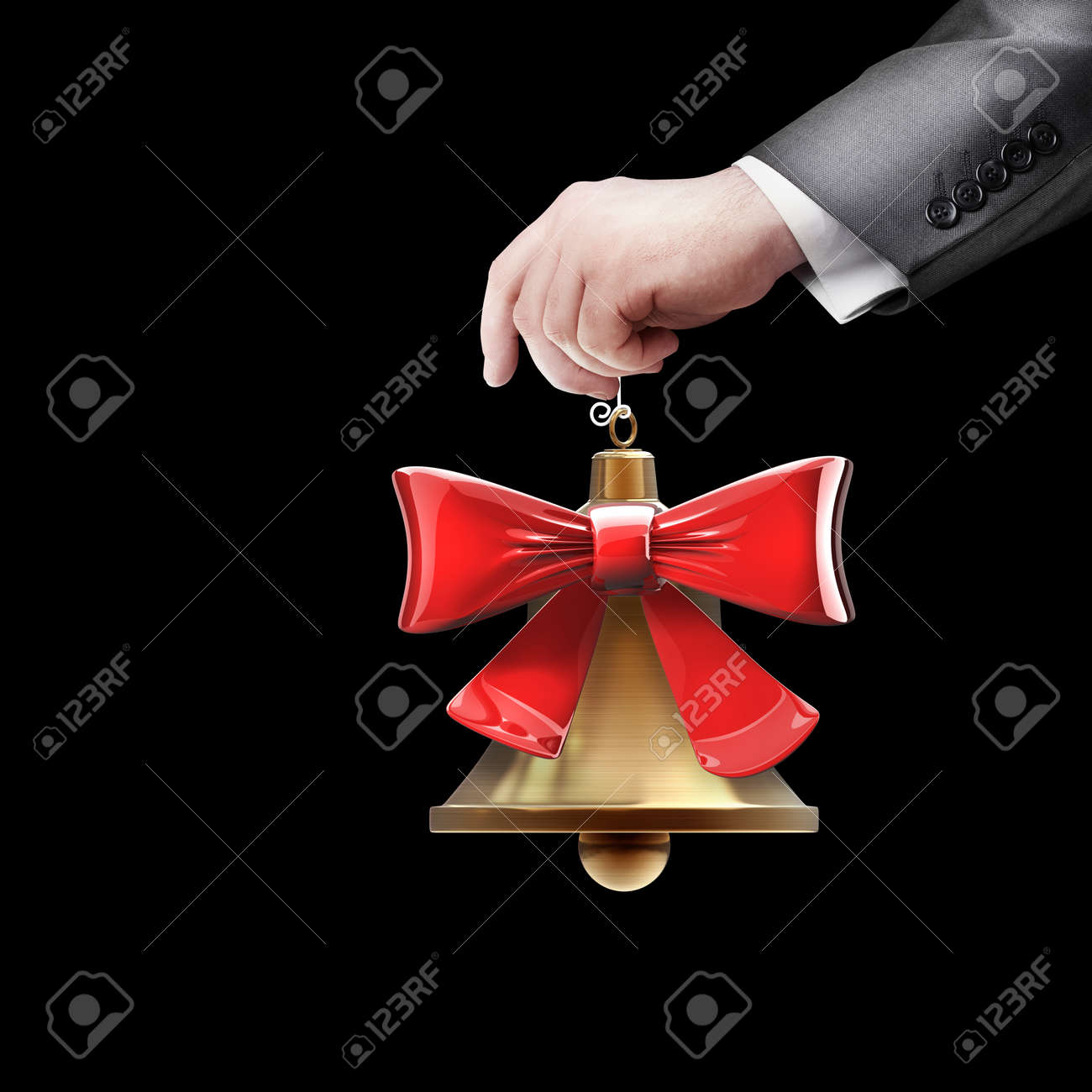 hand holding object (Christmas handbell) isolated on black background