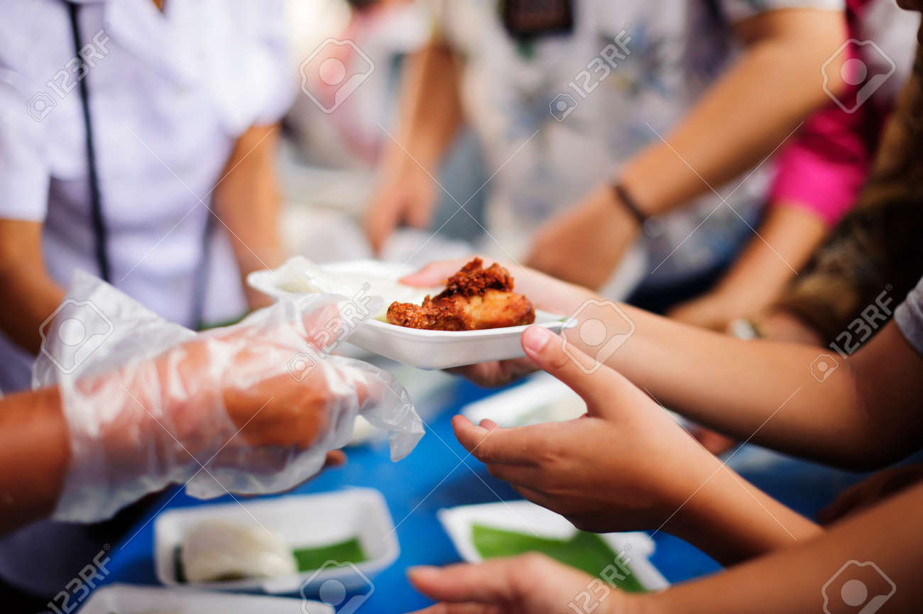 Volunteers provide food for beggars : Concepts Feeding and help : Concept of food sharing for the poor to alleviate hunger : Volunteers Share Food to the Poor - 124397867