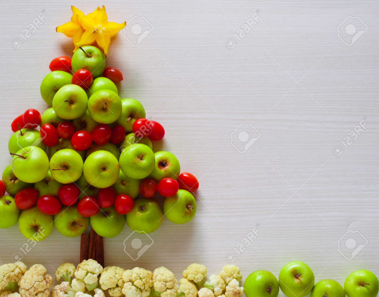 Christmas Tree Fruit.Christmas Tree Decorations Made From Apple Cherry Tomatoes