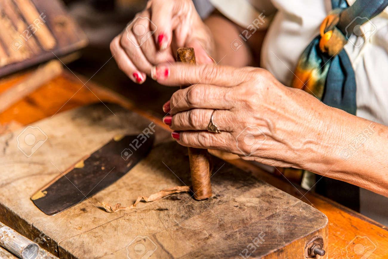 Close-Up photo of a woman preparing a cuban cigar in Casa de la Cultura, Trinidad, Sancti Spritus Province, Cuba, West Antilles, Central America. Photo taken on 3rd of November, 2019 - 122272138