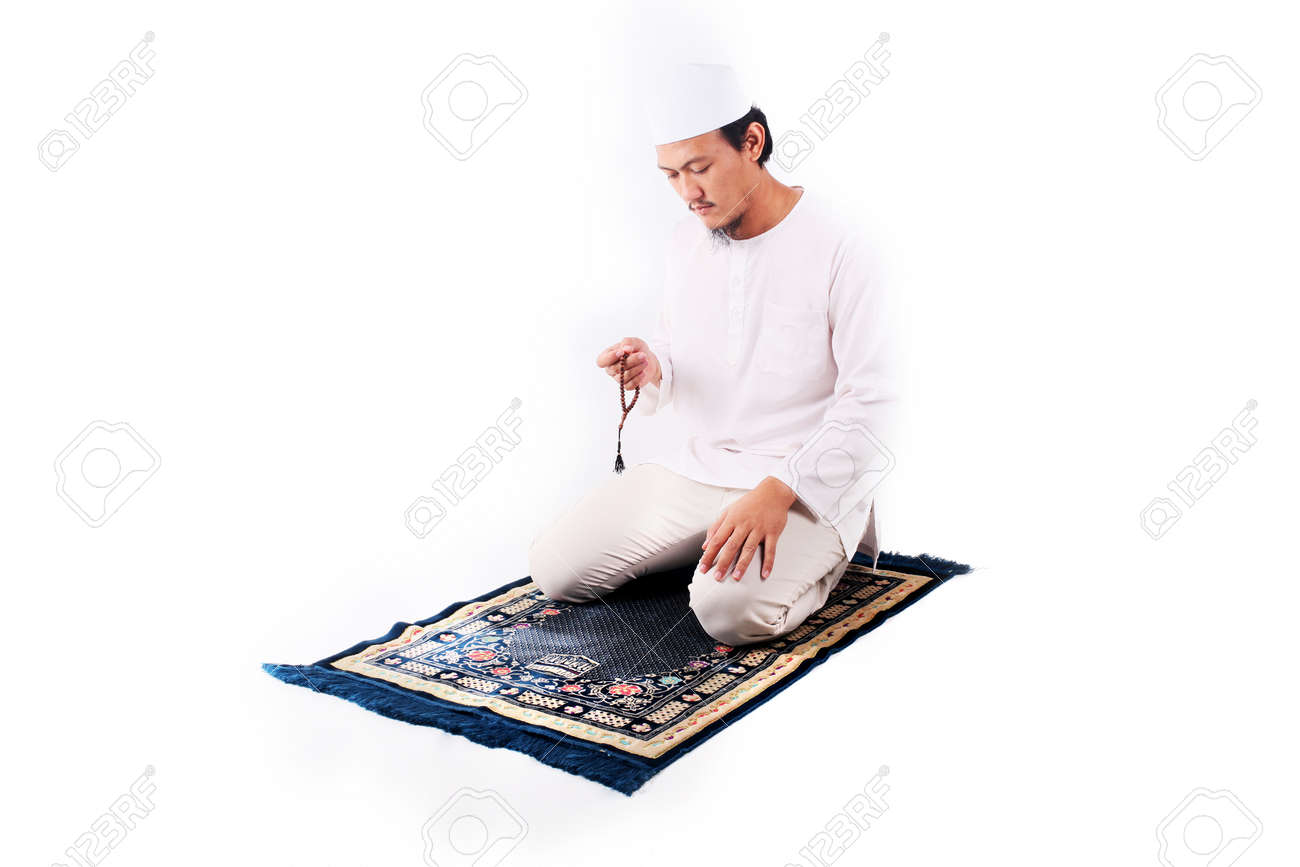 Religious asian muslim man praying isolated on white background - 123018289