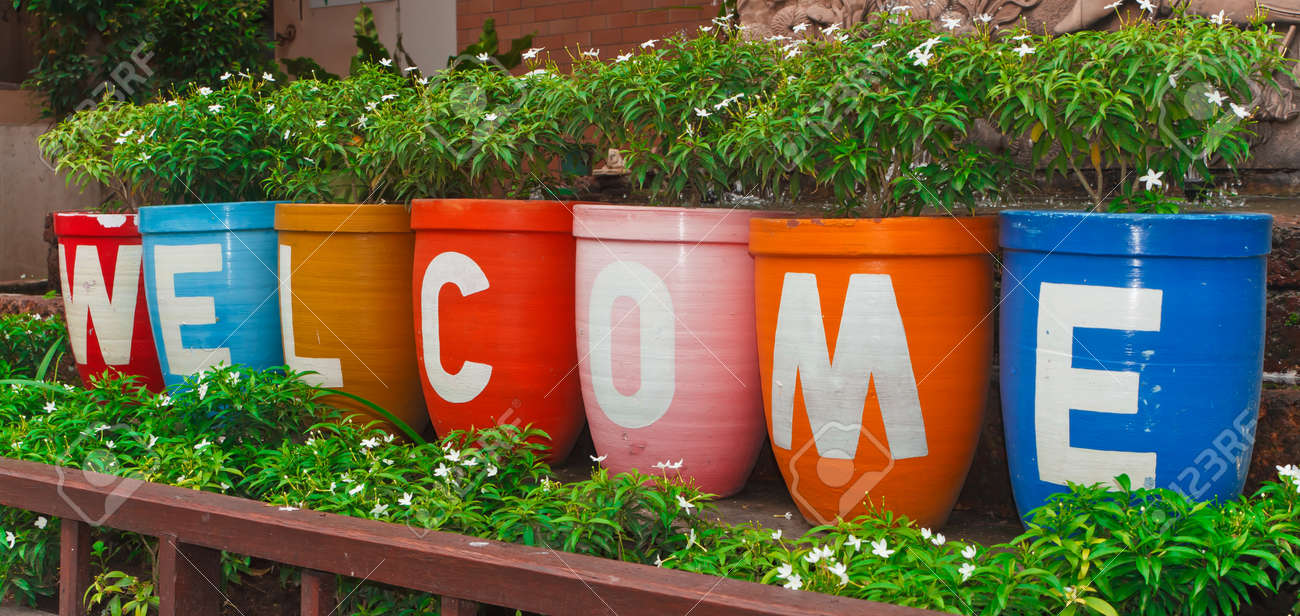 welcome sign, at the flower pot. stock photo, picture and royalty