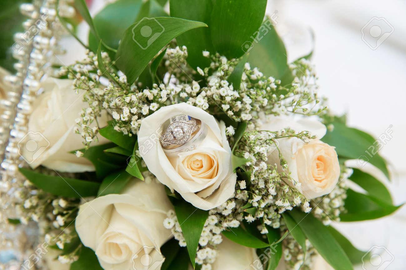 Beautiful white wedding bouquets in basket bouquet flowers rose beautiful white wedding bouquets in basket bouquet flowers rose wedding rings stock photo 86529906 izmirmasajfo