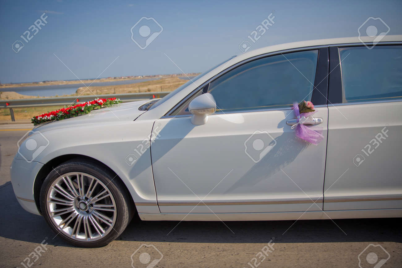 Closeup Image Of Wedding Car Decoration With Red And White Flowers Stock Photo Picture And Royalty Free Image Image 122341863