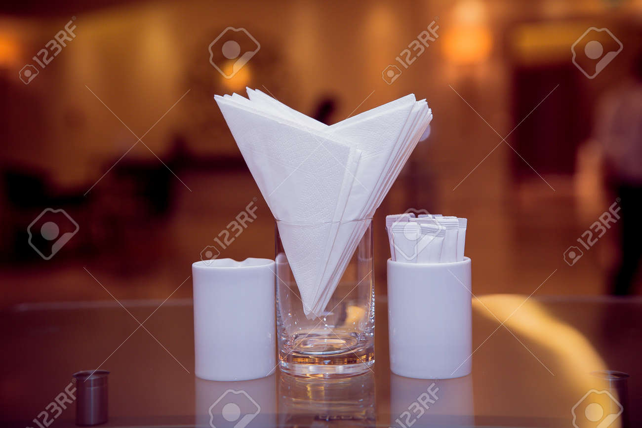 A Table In A Cafe Or Restaurant White Napkins In A Metal Napkin Stock Photo Picture And Royalty Free Image Image 136987714