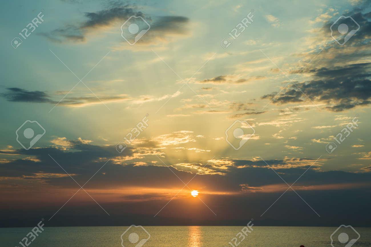 The sunset, the sea and the clouds. Caspian Sea. Azerbaijan Baku Beautiful sunset in yellow as background. Azerbaijan nature - 145480058