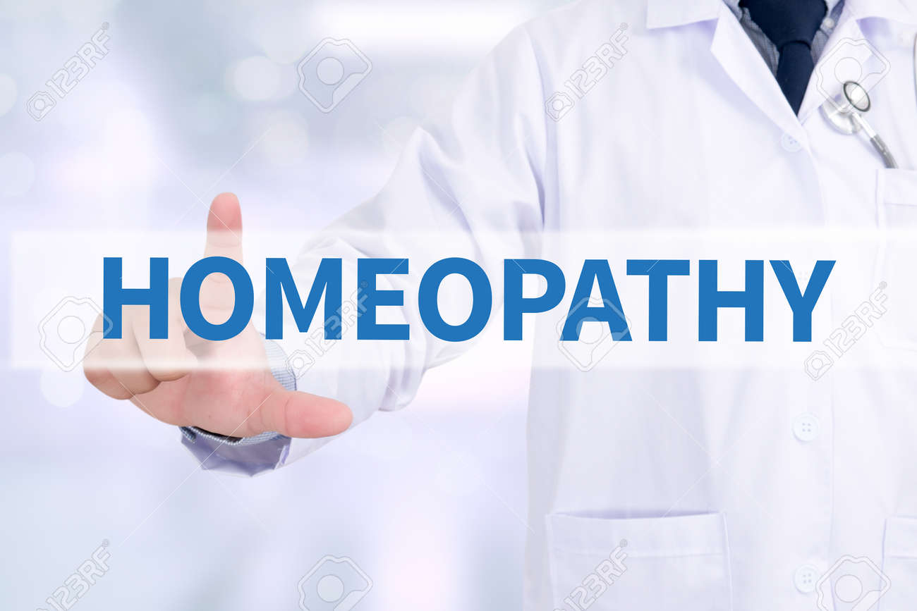 HOMEOPATHY Medicine doctor working with computer interface as