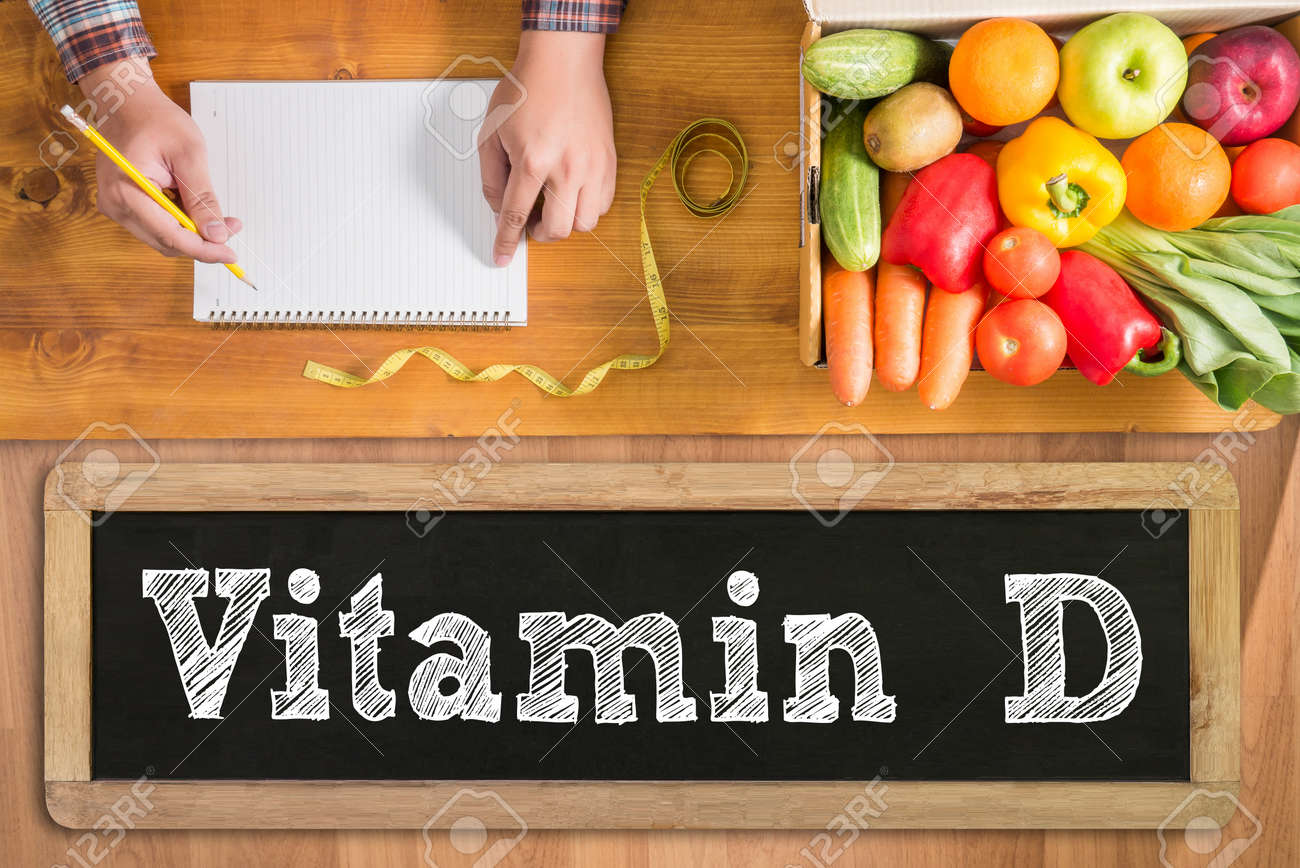 Vitamin D fresh vegetables and on a wooden table