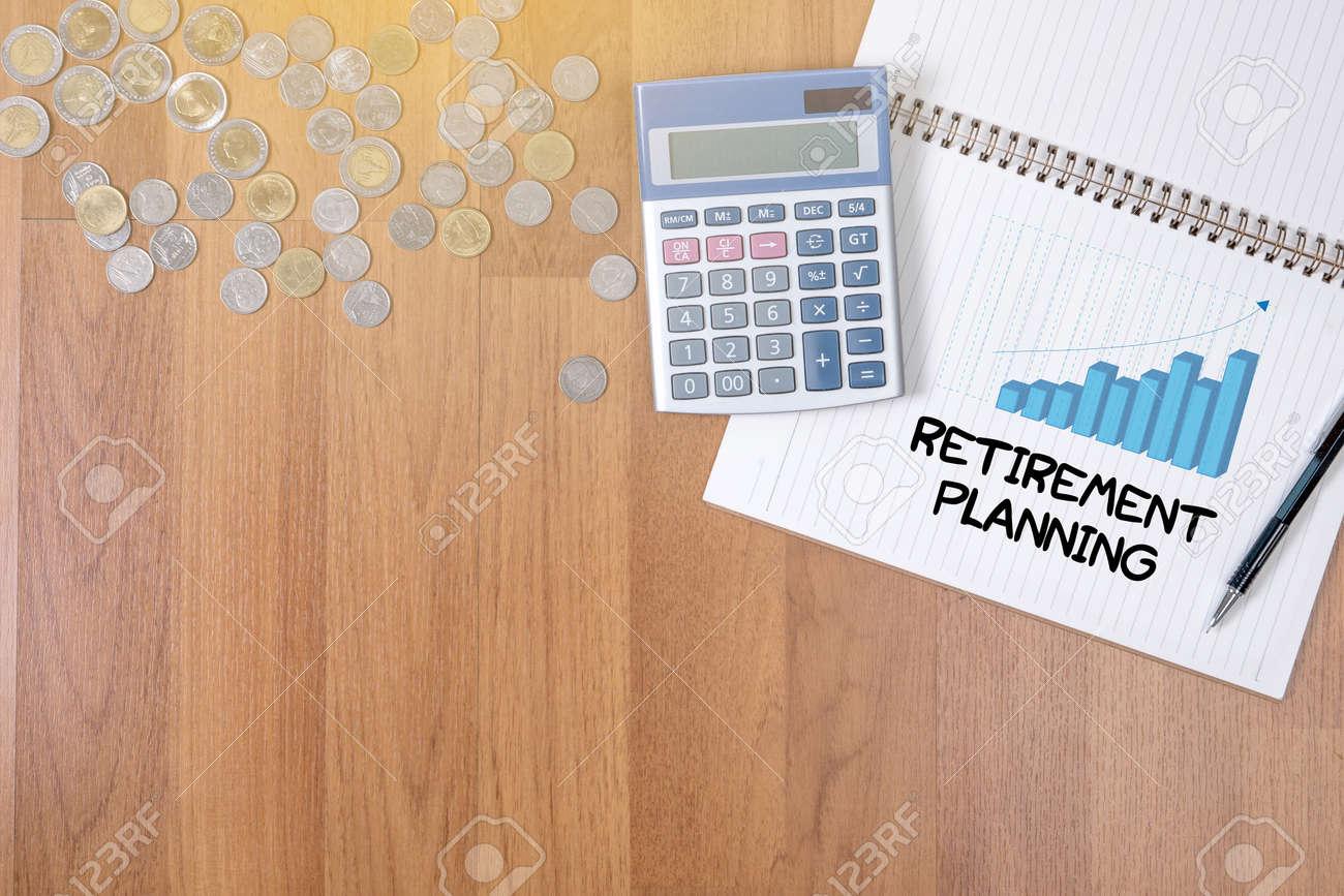 Retirement planning A finance Money, calculator notes, calculator top view work - 63736780