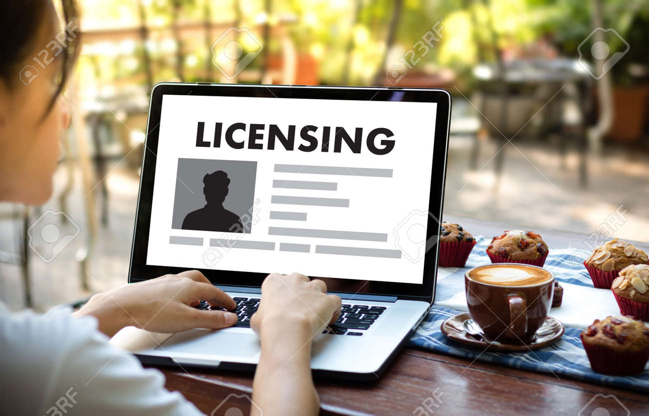 Patent license agreement licensing business man hand working stock patent license agreement licensing business man hand working on laptop computer stock photo 73959460 platinumwayz