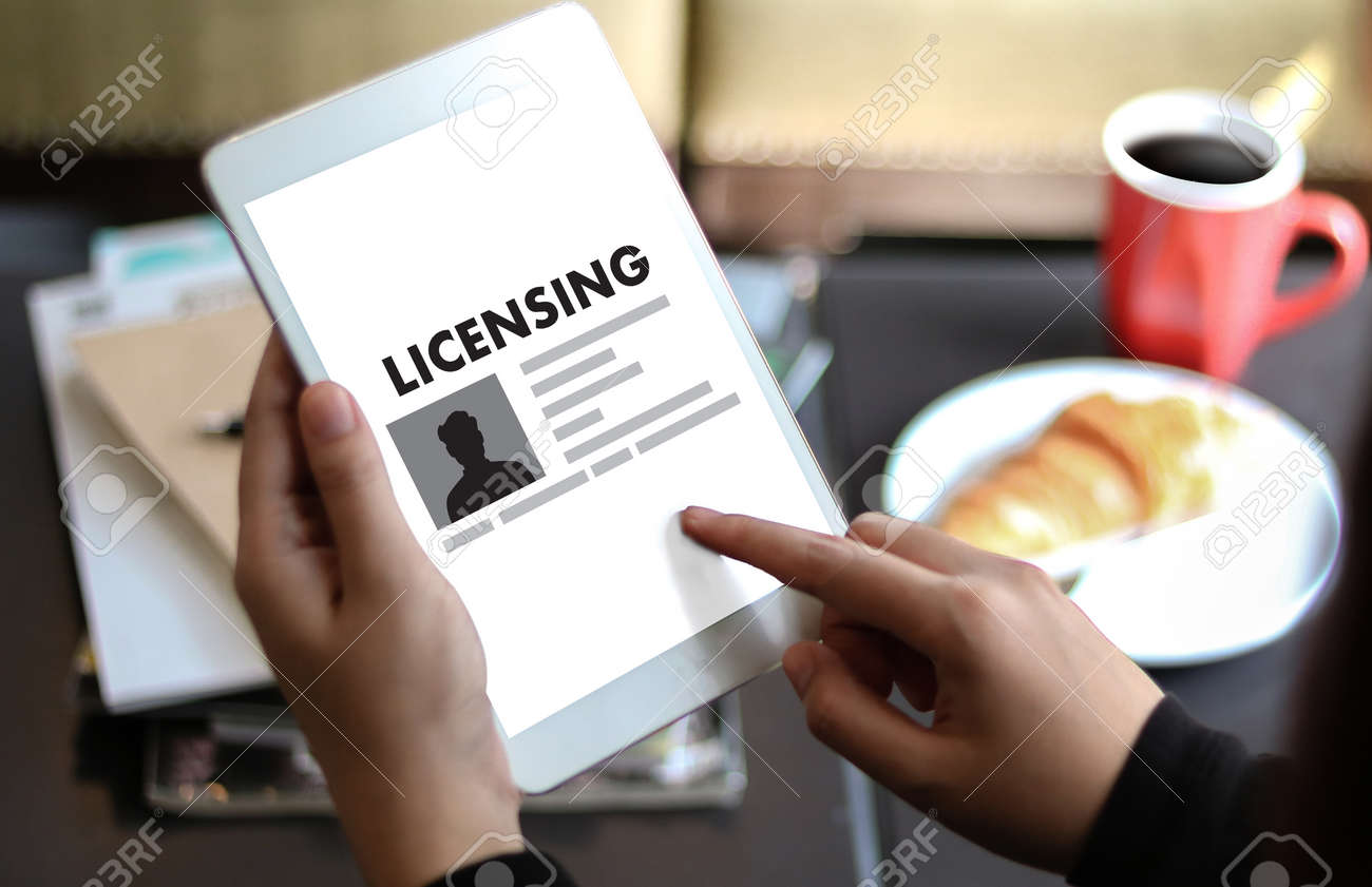 Patent license agreement licensing business man hand working stock patent license agreement licensing business man hand working on laptop computer stock photo 73919591 platinumwayz