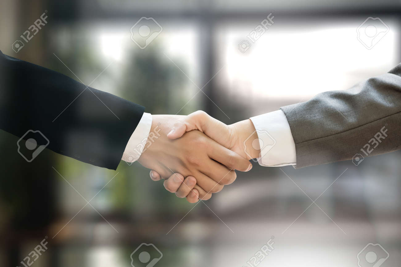M&A (MERGERS AND ACQUISITIONS) , Businessman handshake working at office M&A - 77883354