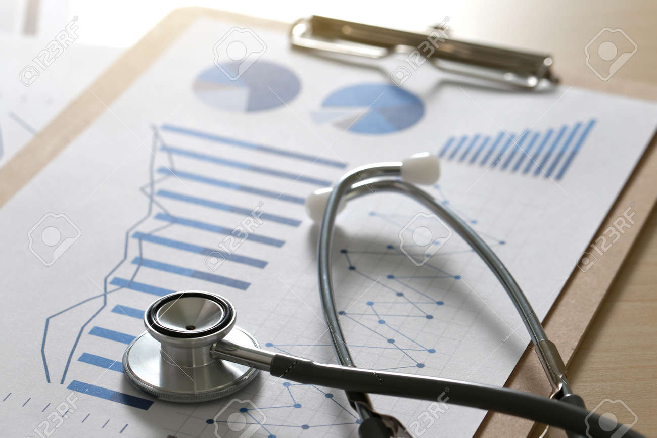 financial report chart and calculator Medical Report and stethoscope - 81229902
