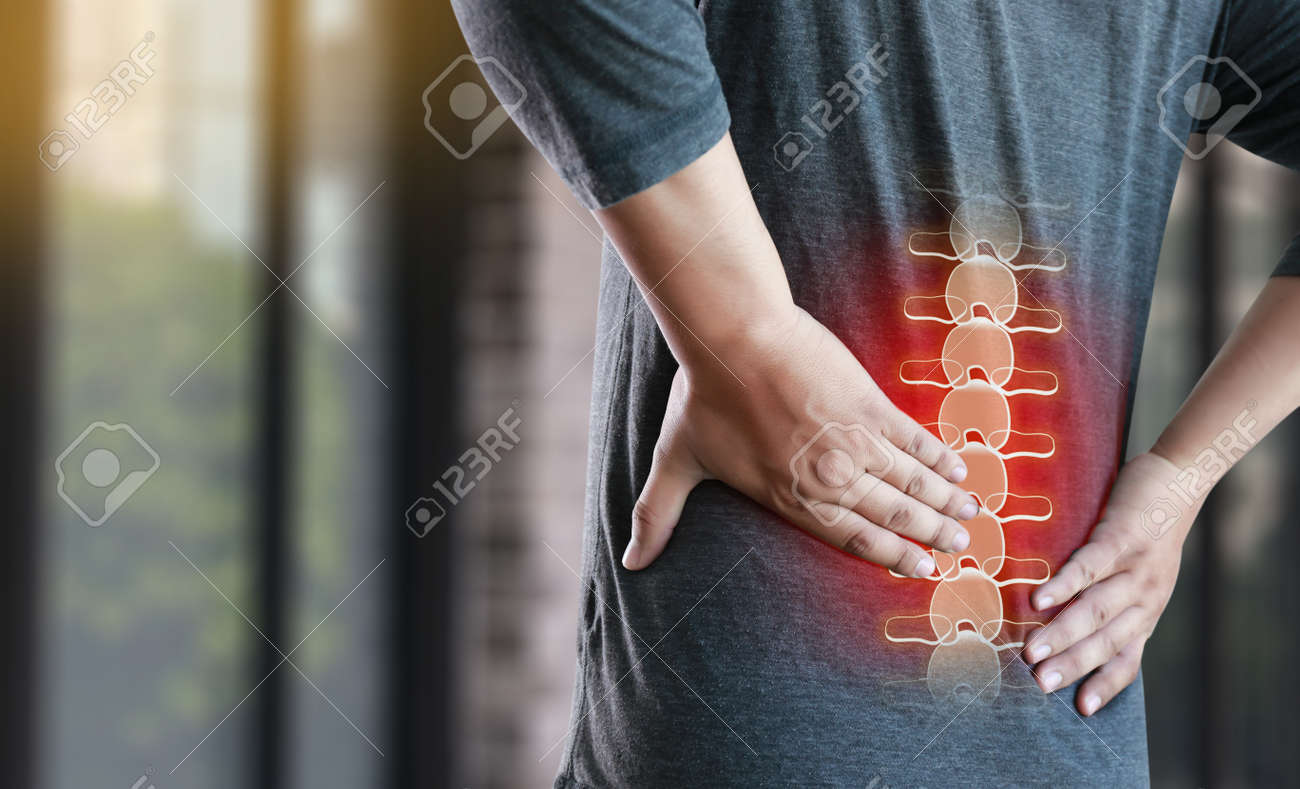 young man Feeling suffering Lower back pain Pain relief concept - 87113009