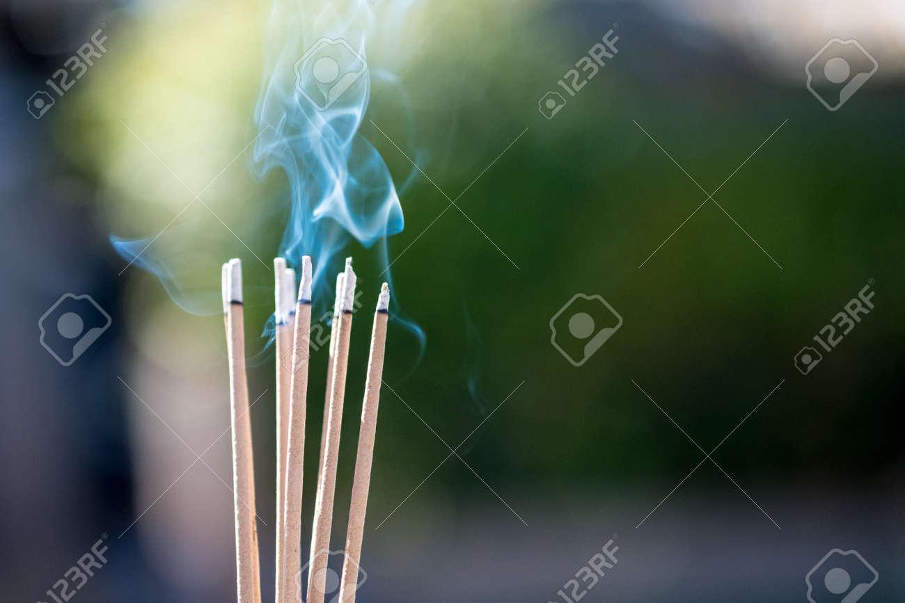 burning Embossed sticks and smoke from incense burning and smoke - 95995999