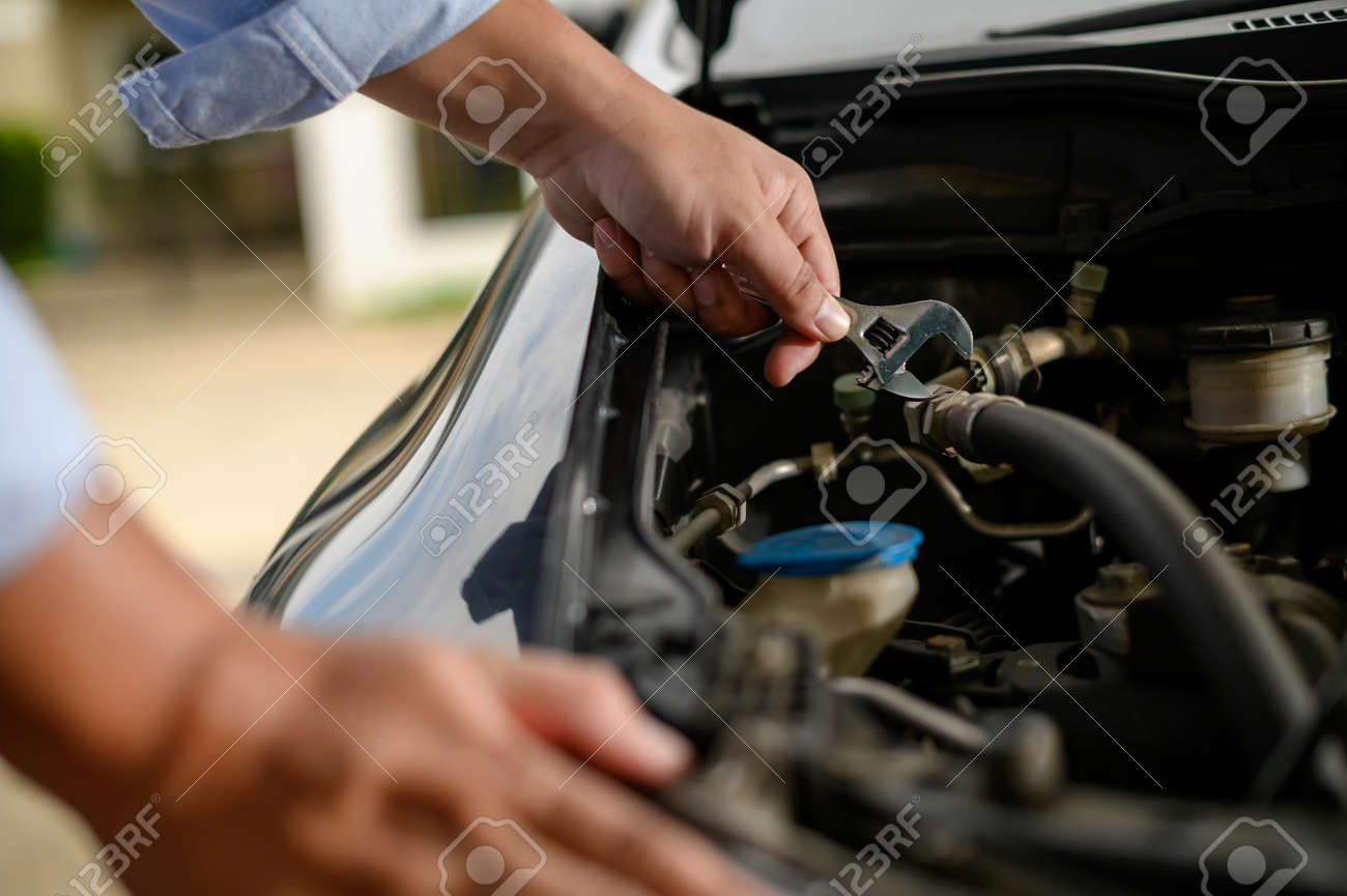 Repair service car Auto mechanic working in garage car mechanic with wrench in garage - 125124093