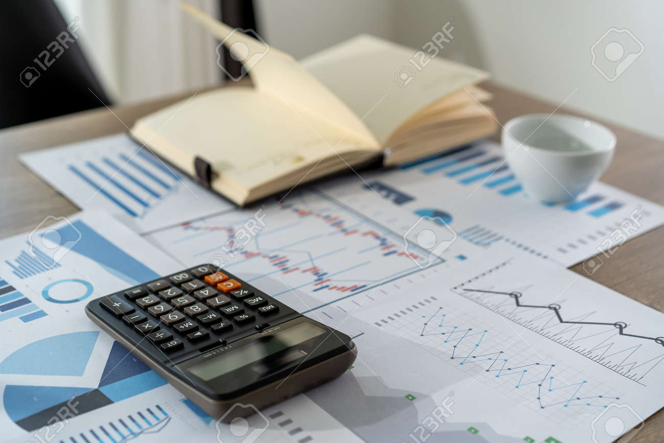 businessman working using a calculator finance accounting concept achievement to balance man assistant accounting - 131443550