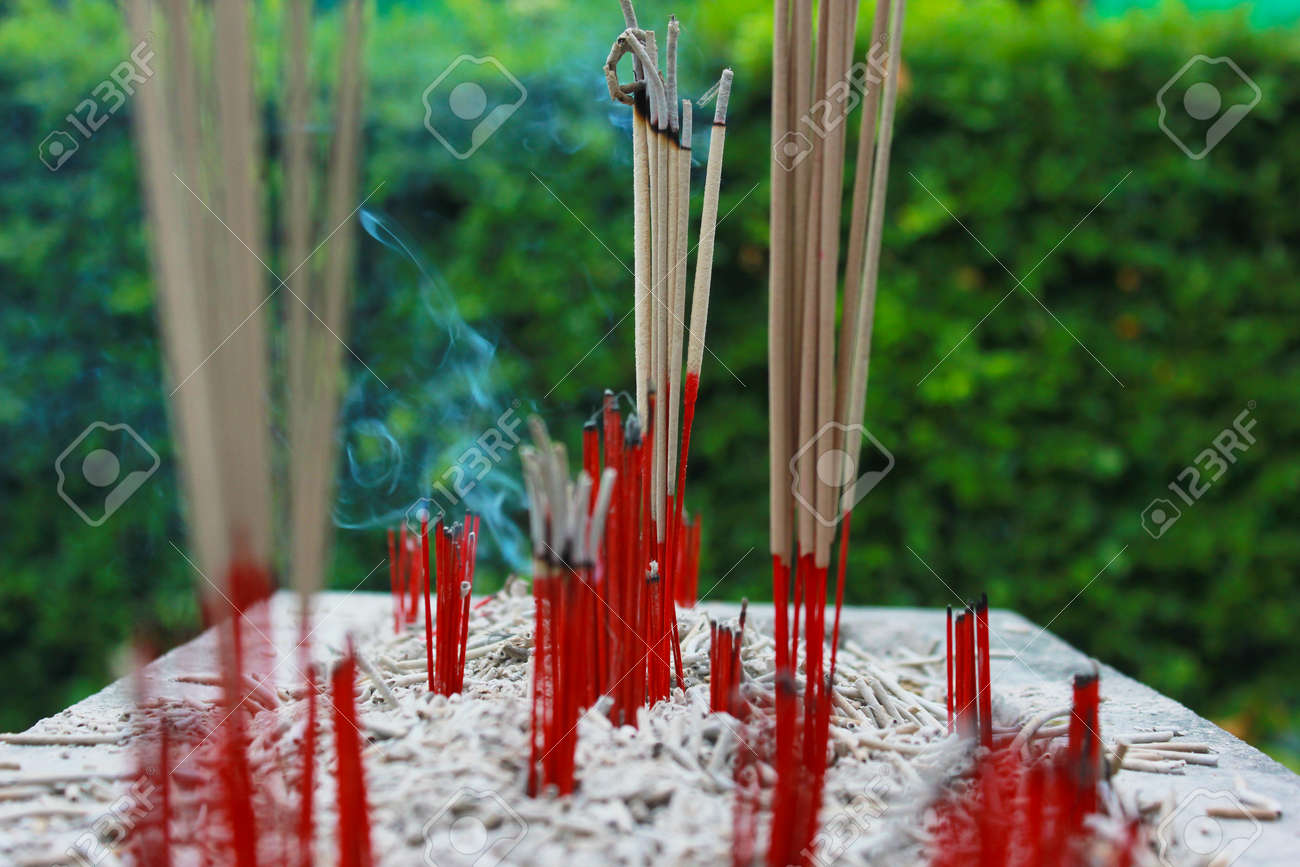 Incense sticks in ashes bucket Stock Photo - 29207664