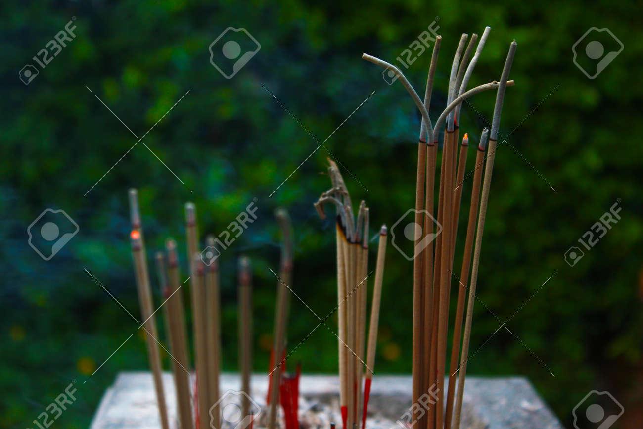 Incense sticks in ashes bucket Stock Photo - 29207843
