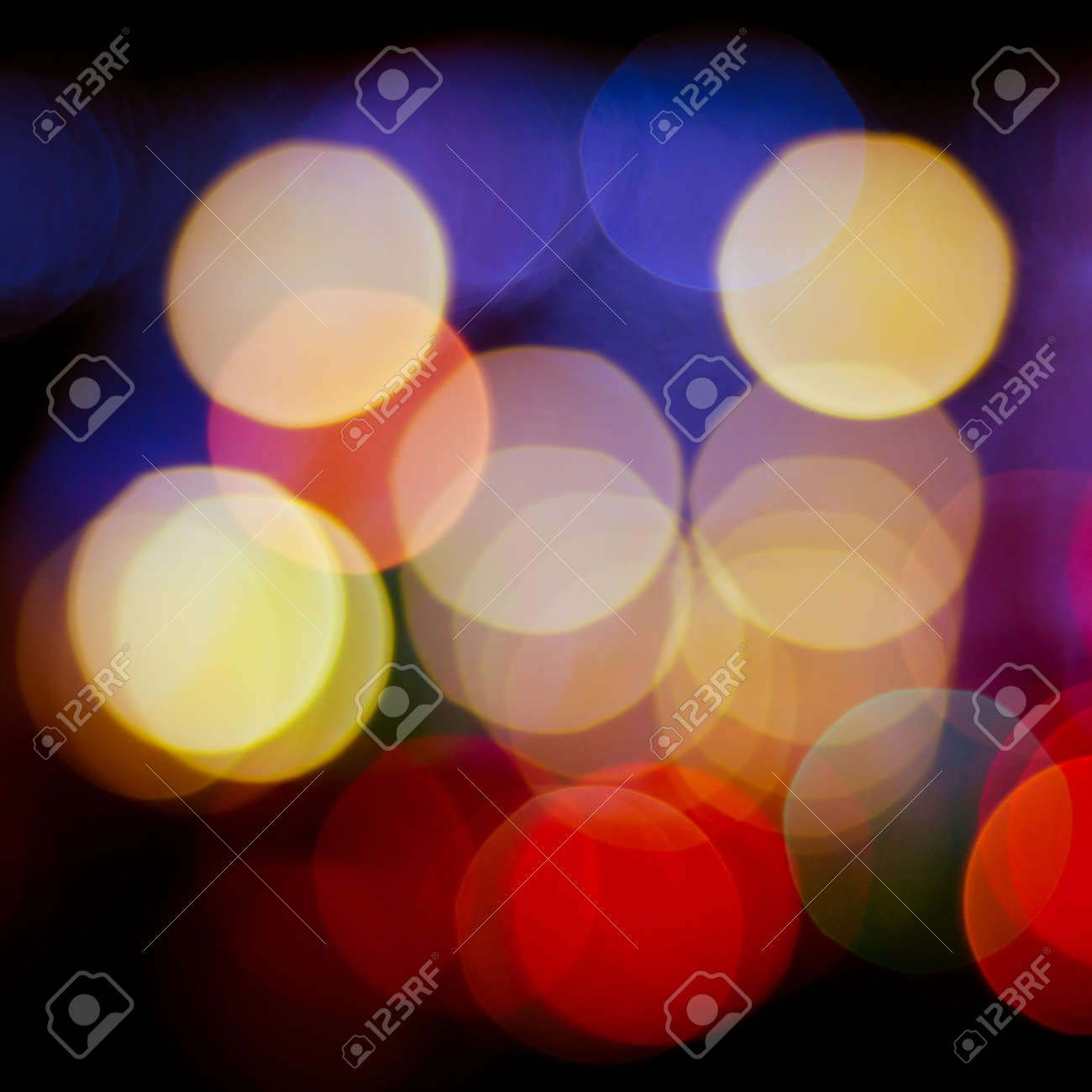 Defocused lights background of city at night. Bokeh sparkling lights. Christmas blurred lights background. Abstract colorful background. Stock Photo - 18003966