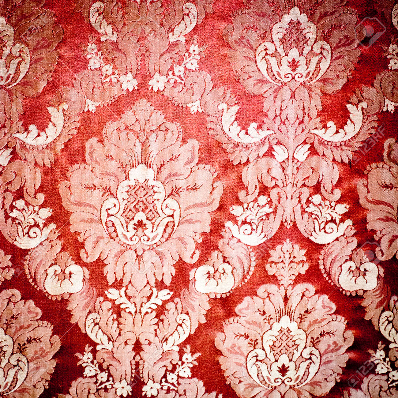 Stock Photo - Vintage damask background wallpaper. Red tapestry fabric.