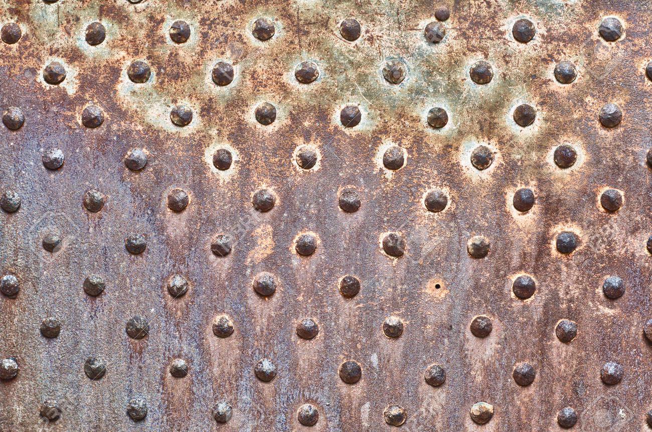 Rusty Metal Door rusty metal texture. studded iron plate. rivets on old, rusty