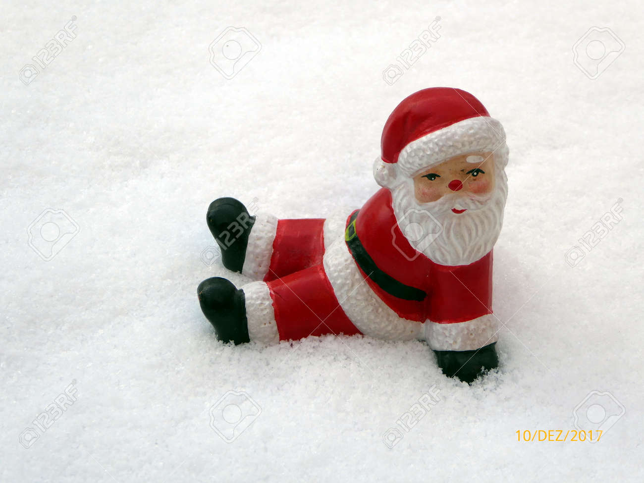 Ceramic Santa Claus On Snow Background. Lovely Merry Christmas ...