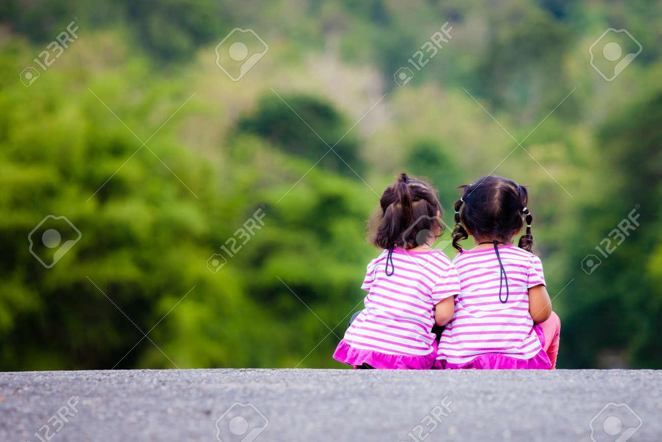little girl sit ground Alamy