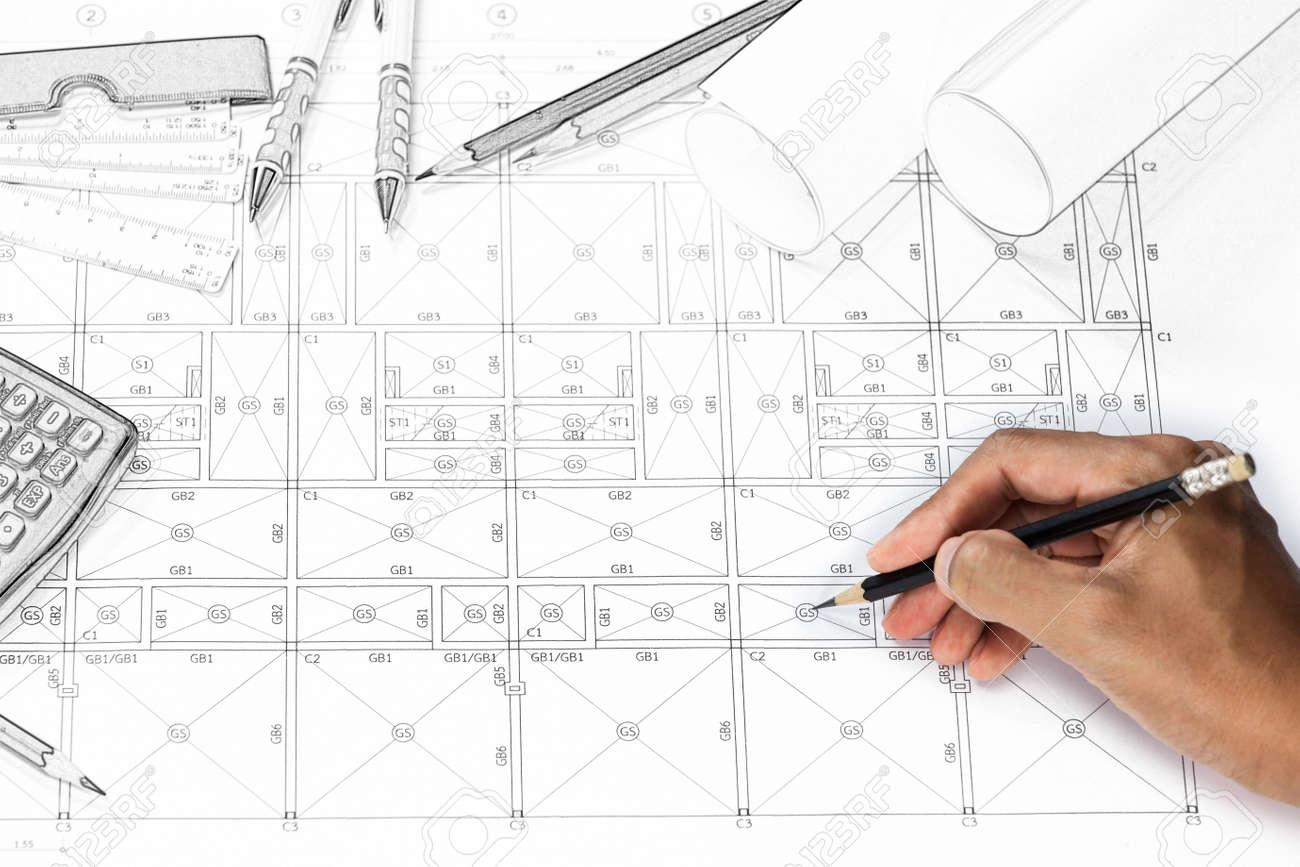 close up of person engineer hand drawing plan on blue print with