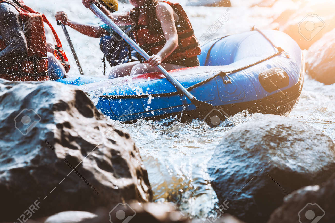 Young person rafting on the river, extreme and fun sport at tourist attraction - 85092781