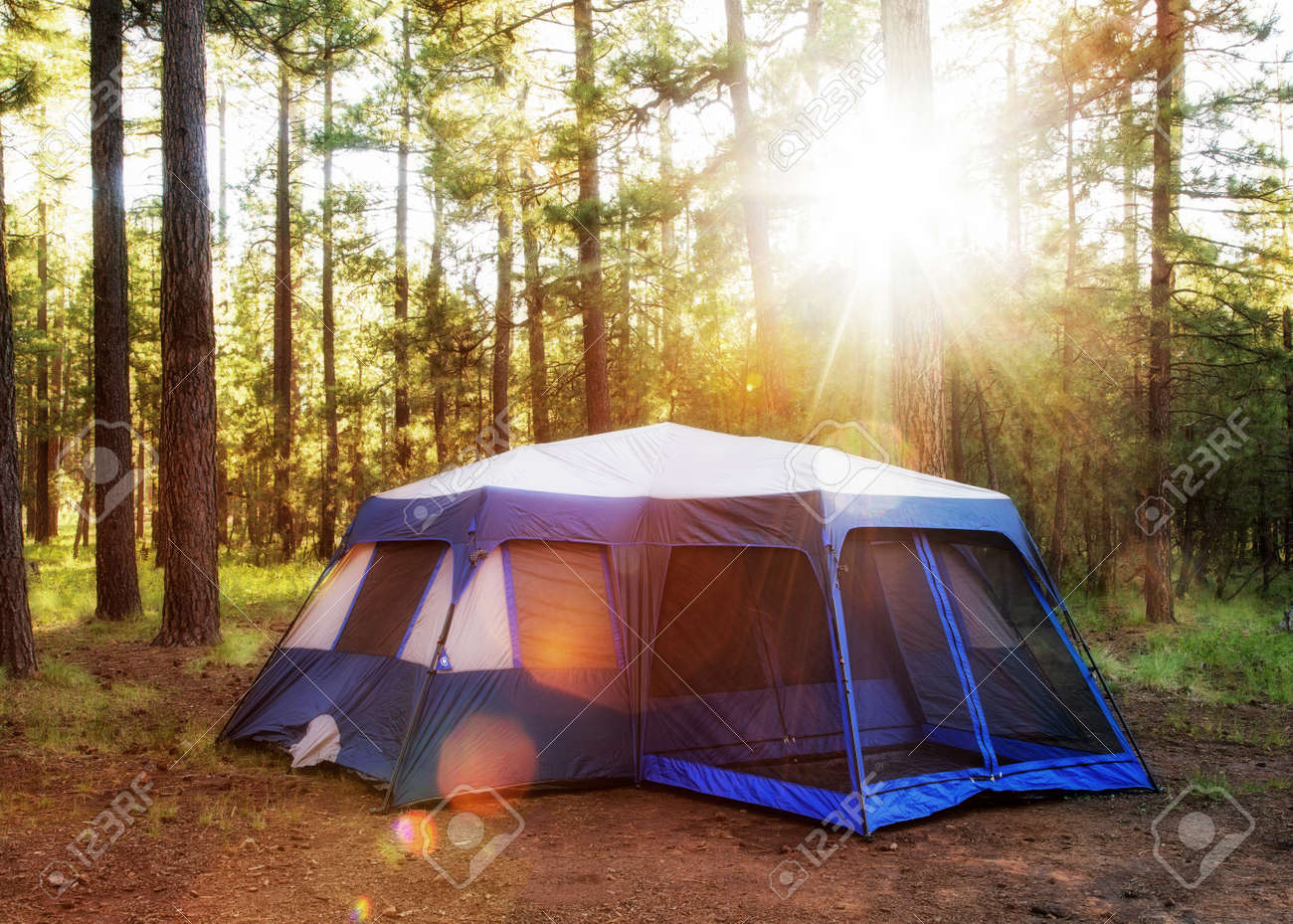Large c&ing tent in the woods of Payson Arizona at sunrise with sun flares Stock & Large Camping Tent In The Woods Of Payson Arizona At Sunrise ...