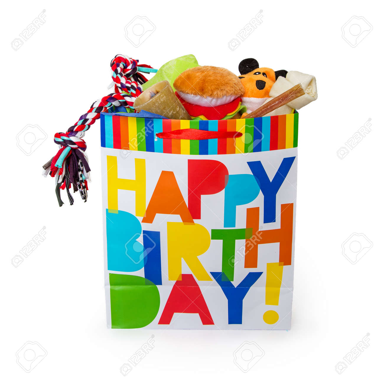 Colorful Happy Birthday Gift Bag Filled With Toys And Treats For A Pet Dog Stock Photo