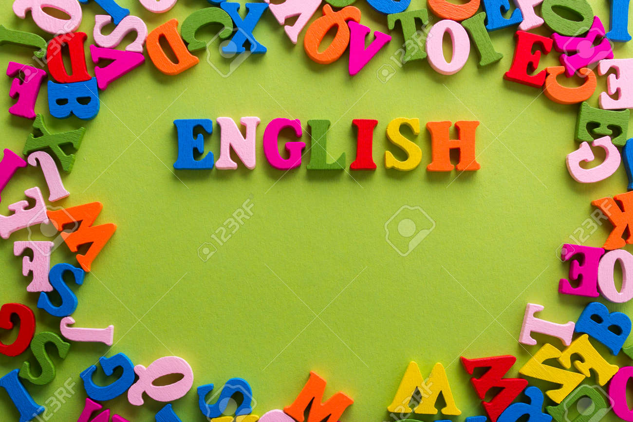 Word of English of color wooden letters of the alphabet on a blue background - 70759948