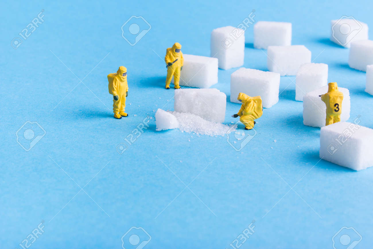 The team investigates the sugar cubes on a blue background - 73923368