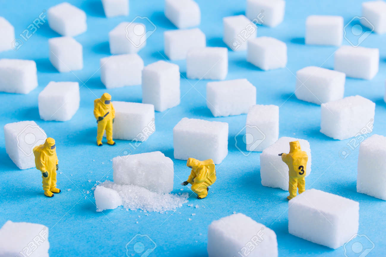 The team investigates the sugar cubes on a blue background - 73923383