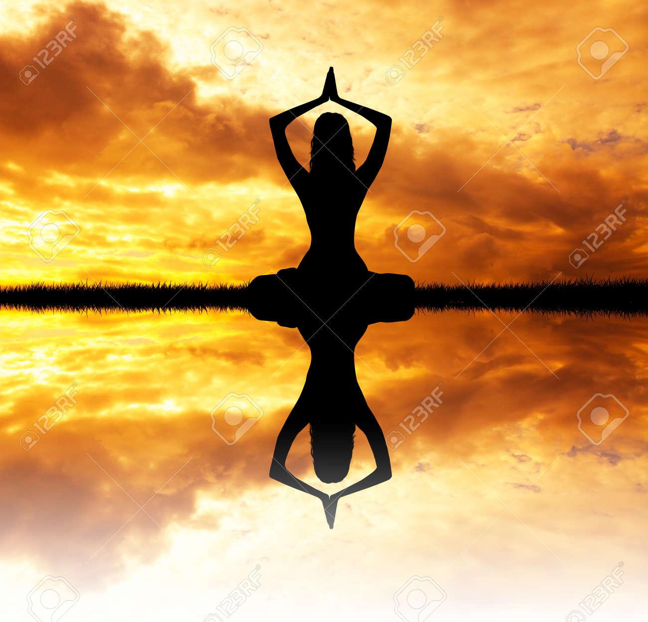 yoga at sunset Stock Photo - 27270994