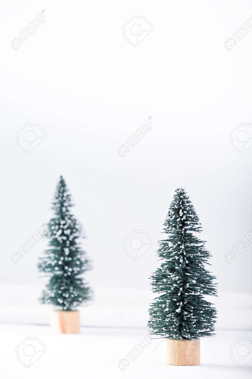 Miniature Toy Christmas Tree On A Wooden Table. Imitation Realistic ...