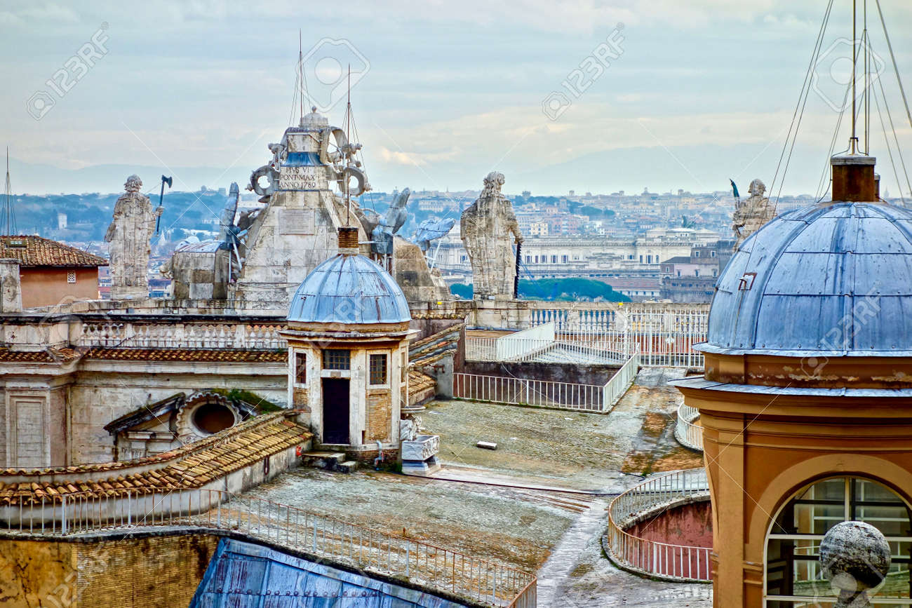 on the roof of the peters dome, Vatican, Rome, Italy with sculpture and cloudy skay in the background - 94871355