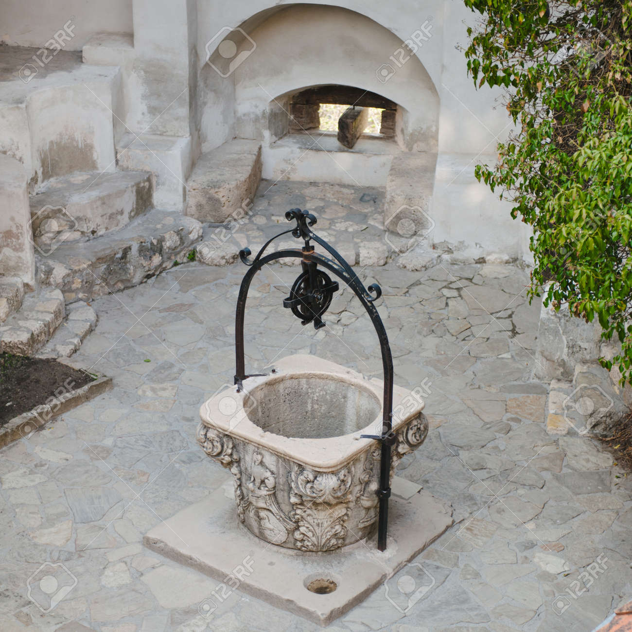 """Water fountain at Bran Castle (Dracula's Castle), in Transylvania, Romania. This fountain is found in the internal courtyard of the Castle and it is well known forfor its """"make a wish"""" qualities. Stock Photo - 19254382"""