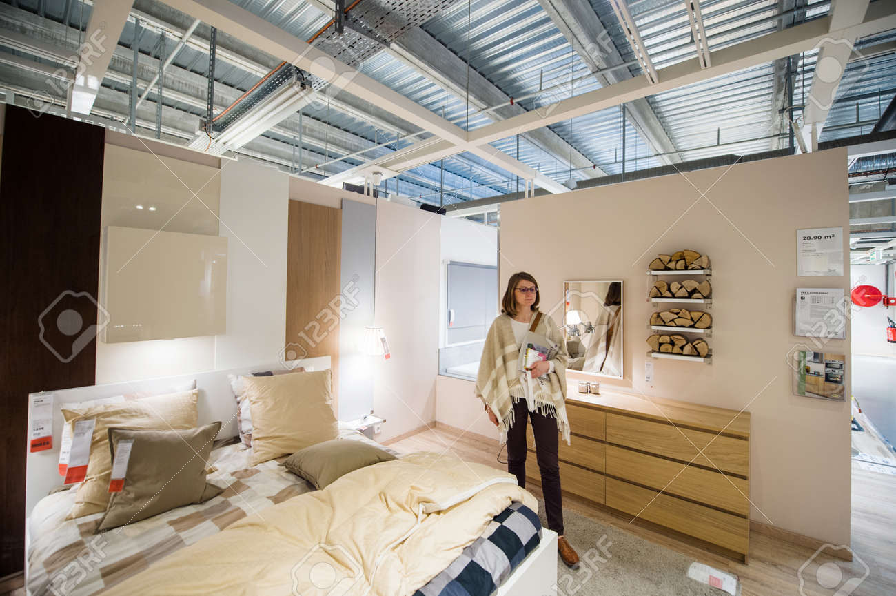 PARIS, FRANCE   APR 12, 2016: Elegant Woman Choosing Bedroom Furniture In  The