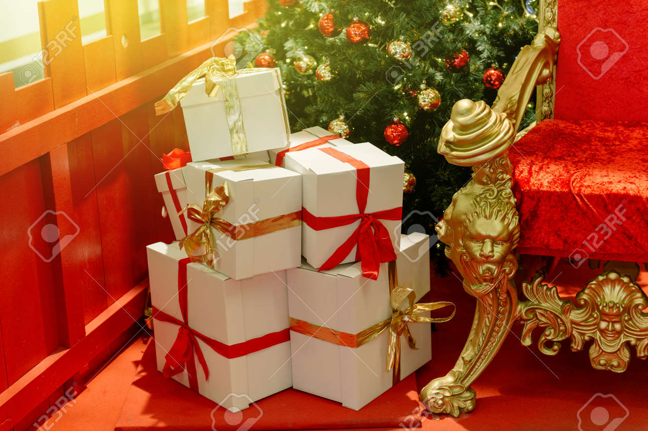 Elegant Christmas gifts presents boxes wraped with red ribbon..