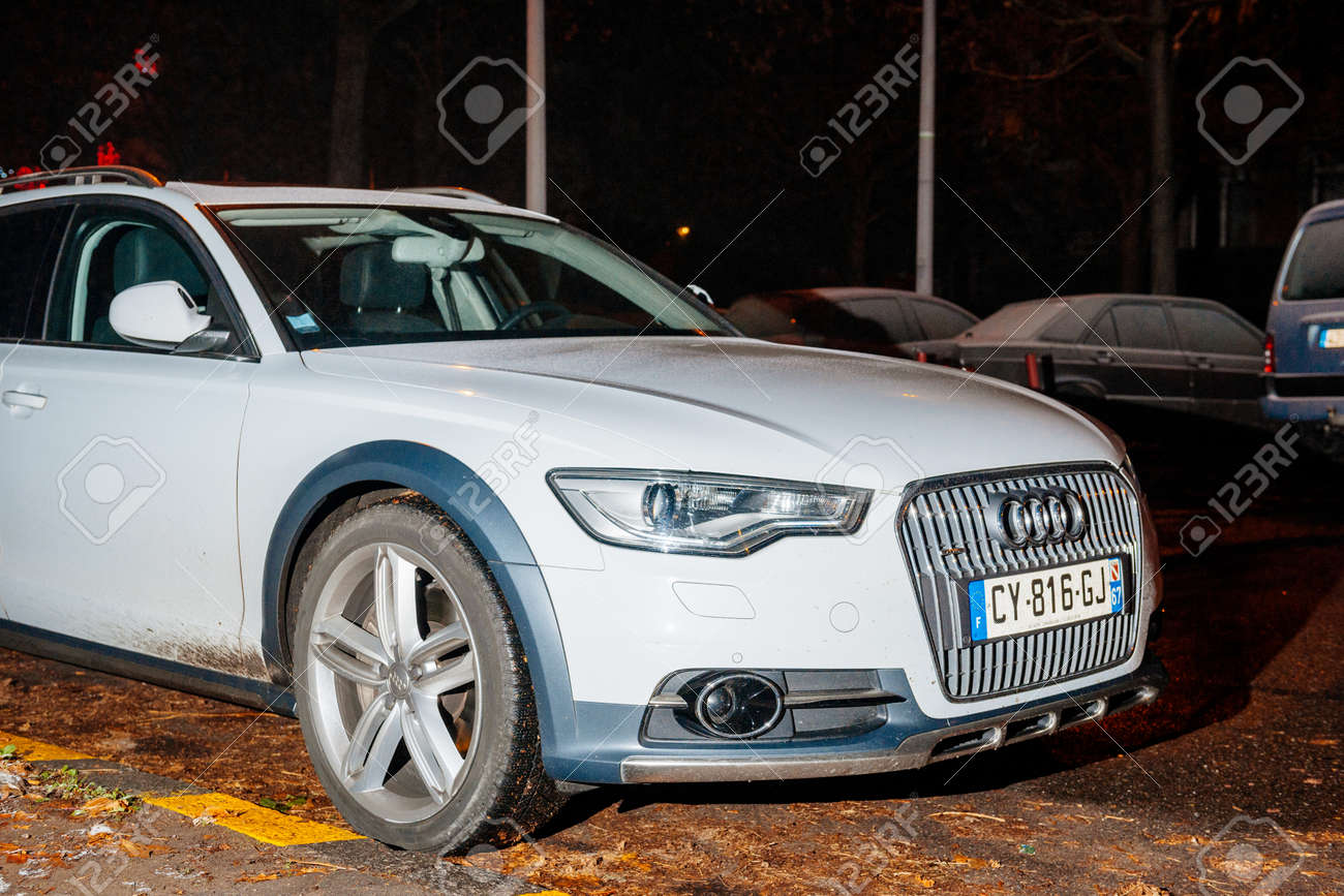 Stock Photo   STRASBOURG, FRANCE   DEC 6, 2017: White Audi A6 Allroad Car  Parked At Night In The City