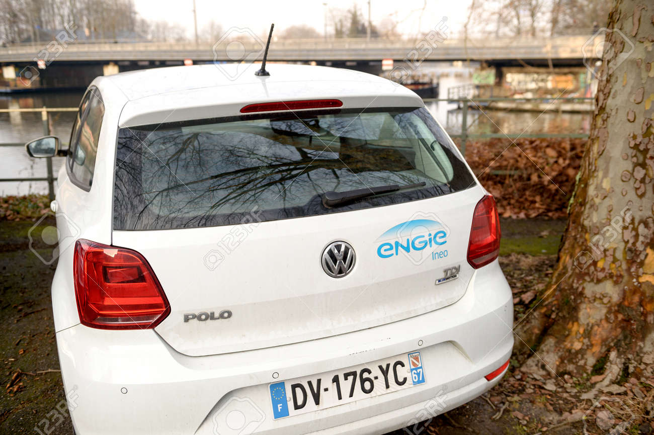 Strasbourg france feb 2 2017 white volswagen polo mini car parked in front of a lake with engie sticker engie is a french multinational electric